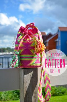 Crochet pattern (English & Dutch) PDF Mini Mochila bag with ply splitted strap in fuchsia, green, yellow and rose. Are you just as excited about tapestry crochet and specific about crocheting a Mochila bag like me?Then, this extensive crochet pattern is really nice for you! This Mini