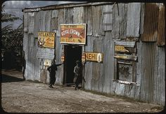 """*African American migratory workers by a """"juke joint"""". Belle Glade, Florida, February 1941. Reproduction from color slide. Photo by Marion Post Wolcott. Prints and Photographs Division, Library of Congress"""