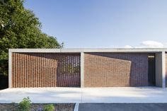 Image 1 of 15 from gallery of Primary School La Couyere / Atelier architectes. Courtesy of Atelier architectes Brick Architecture, School Architecture, Sustainable Architecture, Ancient Architecture, Landscape Architecture, Brick Design, Facade Design, House Design, Arch House