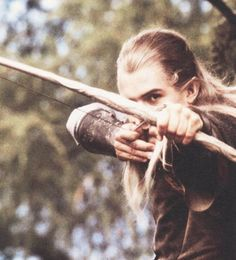 Legolas, Lord of the Rings..we'd pretend we were in harry potter. and for years we would pretend to be in lord of the rings and I was usually legolas because everyone wanted to be strider. sight/bow <3. grew up in north dakota. in snow/ open range we'd pretend to be on journeys. discover dead beavers and shit.