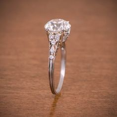 A rare Antique Edwardian Engagement Ring by Estate Diamond Jewelry. Circa 1910.  Love the style, but with an oval cut centre diamond. -AP