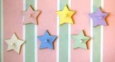 cute star wall pegs...i just need the boy colors to match Riley's room!