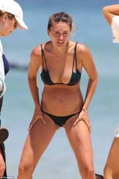 Drop it like it's squat: Kendal showed off her athletic prowess as she took on some squats on the beach - displaying her toned legs as she went