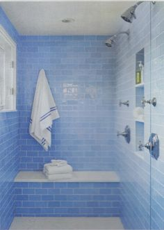 Instead Of Washing Your Bath In White And Incorporating Pops Of Blue, Try  It In Reverse. White Accents, Such As The Shower Seat, Trim And Towels In  This ...