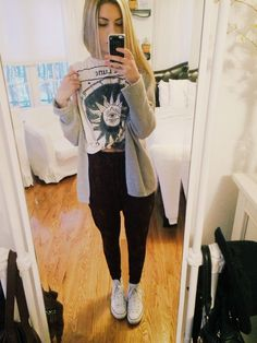 lookin like a hoodlum for school because i will be raging tonight at a concert :-) urban outfitters peplum pants, urban graphic tank, brandy cardigan, white converse! woo have a great day