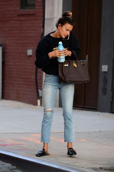 Irina Shayk wearing Brian Lichtenberg Homies Cotton Sweatshirt, Hermes 40 Cm Black Birkin Bag with Gold Hardware, Hermes Birkin Chocolate Brown Fjord 40cm Gold Hardware, Gucci Princeton Fur Slippers and Frame Denim Le Original Cropped Jeans in Gray
