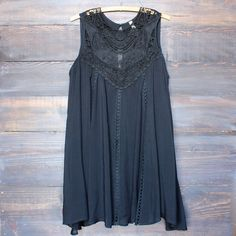 A cute oversized flowy black colored bohemian lace dress. Rich black toned sheer yoke upper lace adorns this darling flirty vintage style dress. - 100% rayon - hand wash cold, lay flat to dry - import