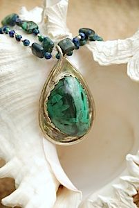 """Photographing Jewelry with a Digital Camera Think of non-traditional """"jewelry displays"""" you can hang your pieces on for photographing."""
