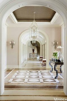 In the entryway to this elegant Texas mansion, the soft color palette and patterned floor create a serene space. The custom table is by Rose Tarlow Melrose House, the pendants are by Dennis & Leen, and the sconces are by Nesle. Tour the entire home Classic Interior, Home Interior, Luxury Interior, Interior Design, Luxury Furniture, Interior Ideas, Modern Interior, Interior Architecture, Furniture Design