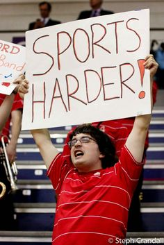 10 Sports Fans With Incredibly Important Signs