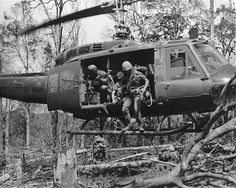 Soldiers from 1st Brigade, 101st Airborne Division (Air Assault), exit a UH-1 Huey during an Air Assault mission in Vietnam. Hueys served a variety of missions in Vietnam including MedEvac, command and control, air assaults, cargo transport and as gunships.