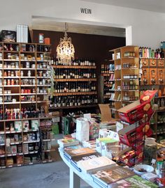 Goldhahn & Sampson in Berlin. Stuffed shelves and a table full of goodies.