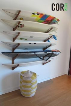 Our triple wall storage rack holds any size board including surfboards, longboards, wakeboards, snowboards and kite boards. Made from eco-friendly and sustainable wood.