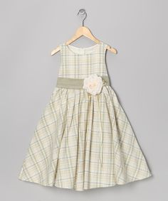 Whether she's there to help host or simply to practice her bunny hop and find hidden treasures, any little reveler will charm one and all when she's decked out in this party-ready piece with its sweeping skirt, mesmerizing print and generous floral accent.PolyesterHand washMade in the USA