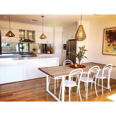 Teak wood dining table, white powder coated legs, white steel bentwood chairs, copper pendant lights, all white kitchen, mirrored splash back