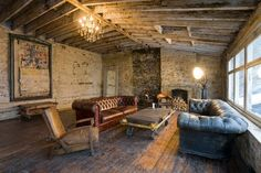brick walls. wooden beam ceilings. old wood floors. aged leather couches.