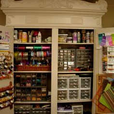 This is an old armoir converted to craft organization...found on google images: awesome;)