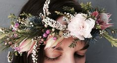Pretty pastel tones and textural elements feature in this flower crown. Includes carnation, blushing bride, thryptomene and sea holly