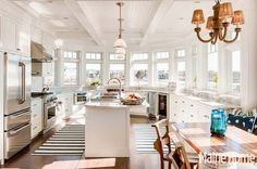 One of the most stunning kitchens I've seen.  Takes bay windows to a whole new level. 101% perfect.