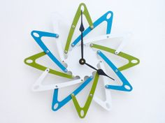 Pinwheel Modern Wall Clock I (Eden, Wildflower Blue, & White) Custom Colors Available on Etsy, $92.00
