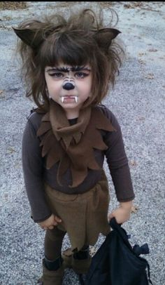 DIY werewolf costume for girls using a brown sweatshirt.