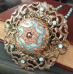 A fine example from theothermagdalene at the Filigree Jewelry Group at Flickr.