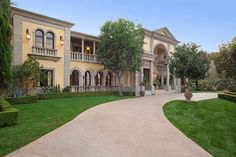 Italian Villa style estate home - Venetian plaster with French limestone trim details