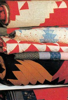 Love a stack of antique quilts
