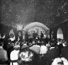 1961 - George Harrison, Paul McCartney, Pete Best and John Lennon, The Cavern Club, Liverpool, England.