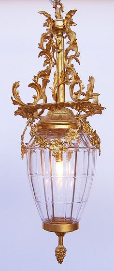 "An Ornate French 19/20th Century Gilt-bronze and molded glass ""Versailles"" style hanging lantern, c. 1900, Paris"