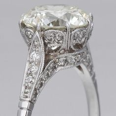 Edwardian Engagement Ring. Love the detail! If it was a square diamond it would be perfect