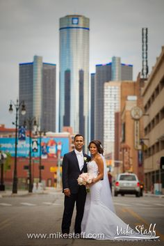 Bride and groom posing in the streets of Downtown Detroit  #Michiganwedding #Chicagowedding #MikeStaffProductions #wedding #reception #weddingphotography #weddingdj #weddingvideography #wedding #photos #wedding #pictures #ideas #planning #DJ #photography #bride #groom
