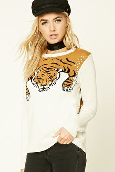 A knit sweater featuring a tiger graphic pattern on the front and back, crew neck, long sleeves, and ribbed trim.