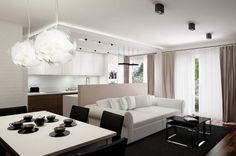 Excelente apartamento pequeño apartamento de diseño de interiores con cómodo sofá blanco y oscuro Tabla Moderno Con la tapa de cristal Y Negro Alfombra también simple Juego de comedor y la idea de la cocina abierta y fresco lámparas colgantes y parquet de madera atractiva y sugerente apartamento Diseño de Interiores