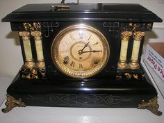 ANTIQUE SETH THOMAS EARLY 1900'S WOOD MANTEL CLOCK SIDE LION HEADS  My dad wound this every night before bed