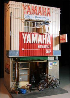 自転車屋さん:ミニチュアワークス [ 小島隆雄 ] / Miniature bike shop - by Takao Kojima.  ★看板には Motorcycle (オートバイ) と書いてあるし、Yamaha だし、間違いかと思ったけど、この pin の大元もやっぱりタイトルが「自転車屋さん」なのね。(^^;;