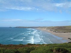 Perranporth, England - stretches three miles on the north Cornwall coast. The beach is flanked on one side by rolling sand dunes which make for an enjoyable walk or, for those of you who are into your fitness, a challenging run. Local riding stables also take rides along the beach and kitesurfers can often be seen towards the north end.  On top of this the beach bar/café, The Watering Hole, which is only accessable via the beach it serves food and drink throughout the seasons and plays host…