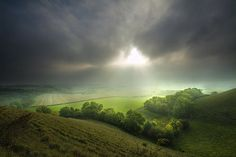 A misty day across rolling hills. Wiltshire, England
