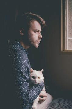 Man holding a kitty.  That's really the important thing about this picture.