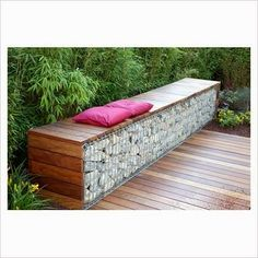 GAP Photos - Garden Plant Picture Library - Bench made from wood and gabions backed by Fargesia murielae - Bamboo hedge - GAP Photos - Specialising in horticultural photography Wall Bench, Wall Seating, Fence Landscaping, Backyard Fences, Farm Fence, Pool Fence, Fence Gate, Garden Seating, Outdoor Seating