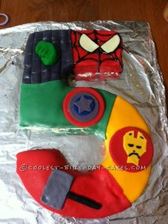 Coolest 5 Shaped Superhero Cake... This website is the Pinterest of birthday cake ideas