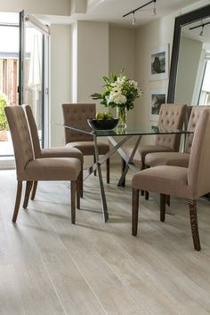 This light laminate flooring (White Wash Oak Planks by Quick-Step) brightens this beautiful neutral toned dining room.