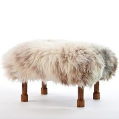 Delyth in Rare Breed is so sweet. The 'Delyth' style has hand turned dark oak coloured legs ending in little hoofs. The luxury sheepskin footstool is handmade in beautiful North Wales. The cover is a removable real British sheepskin cover.