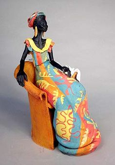 Ceramics by Annie Peaker at Studiopottery.co.uk - Produced in 2006. Blue and Yellow. Figure seated in orange chair, 35cm.
