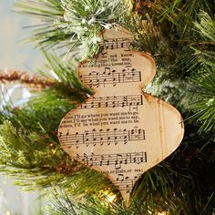 Musical Ornaments-Place old sheet music in water until it is just damp; blot off excess water w/towel. Apply thin, even layer of decoupage medium to a piece of cream cardstock; immediately place the damp sheet music on cardstock. Roll a rubber brayer over sheet music to smooth it & push out air bubbles; let dry. Trace the ornament patterns, @//www.bhg.com/christmas/crafts/christmas-holiday-crafts/#page=17   on white paper,  cut out.