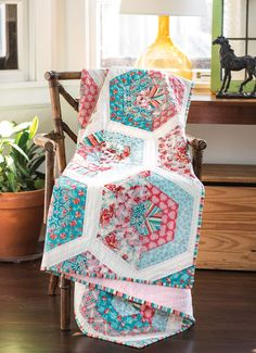 Mary McGuire's retro look starts with strip sets cut into triangles and joined using straight seams. Here, she uses hexagons to create a vintage-inspired quilt with a fresh, modern look.