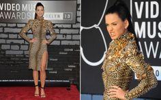"""Até o look do tapete vermelho de Katy Perry remetia ao novo single da cantora """"Roar"""". O vestido midi de animal print, de Emanuel Ungaro, era justinho e tinha uma fenda lateral bem sexy. Para completar o visual, a cantora apostou na moda do grillz."""