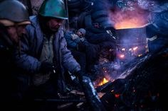 Anti-government protesters warm themselves at a fire near a barricade in Kiev on Jan. A bill passed by Ukraine's parliament that would grant amnesty to arrested activists gives protesters a deadline to leave occupied streets and administrative buildings. Picture Editor, Latest Stories, Pictures Of The Week, Nbc News, Photo Colour, Photojournalism, Around The Worlds, In This Moment, History