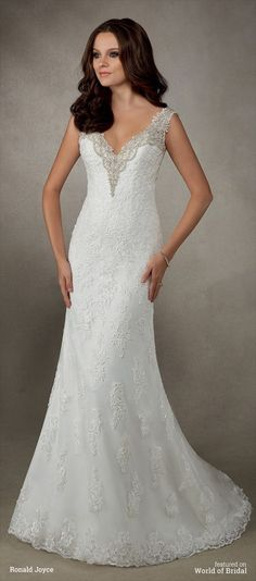 Mermaid Wedding Dresses : A slim fit lace dress with crystal beaded detail low back and tulle train