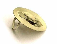 """Supernova Ring by KOBI ROTH-IL """"Kobi Roth creates small landscapes, in a series of loose stains and figurative images. The foundation of his works allows an equal role in the manipulation of solder and raw materials used in traditional jewelry: gold, silver, precious stones, enamel, etc."""""""